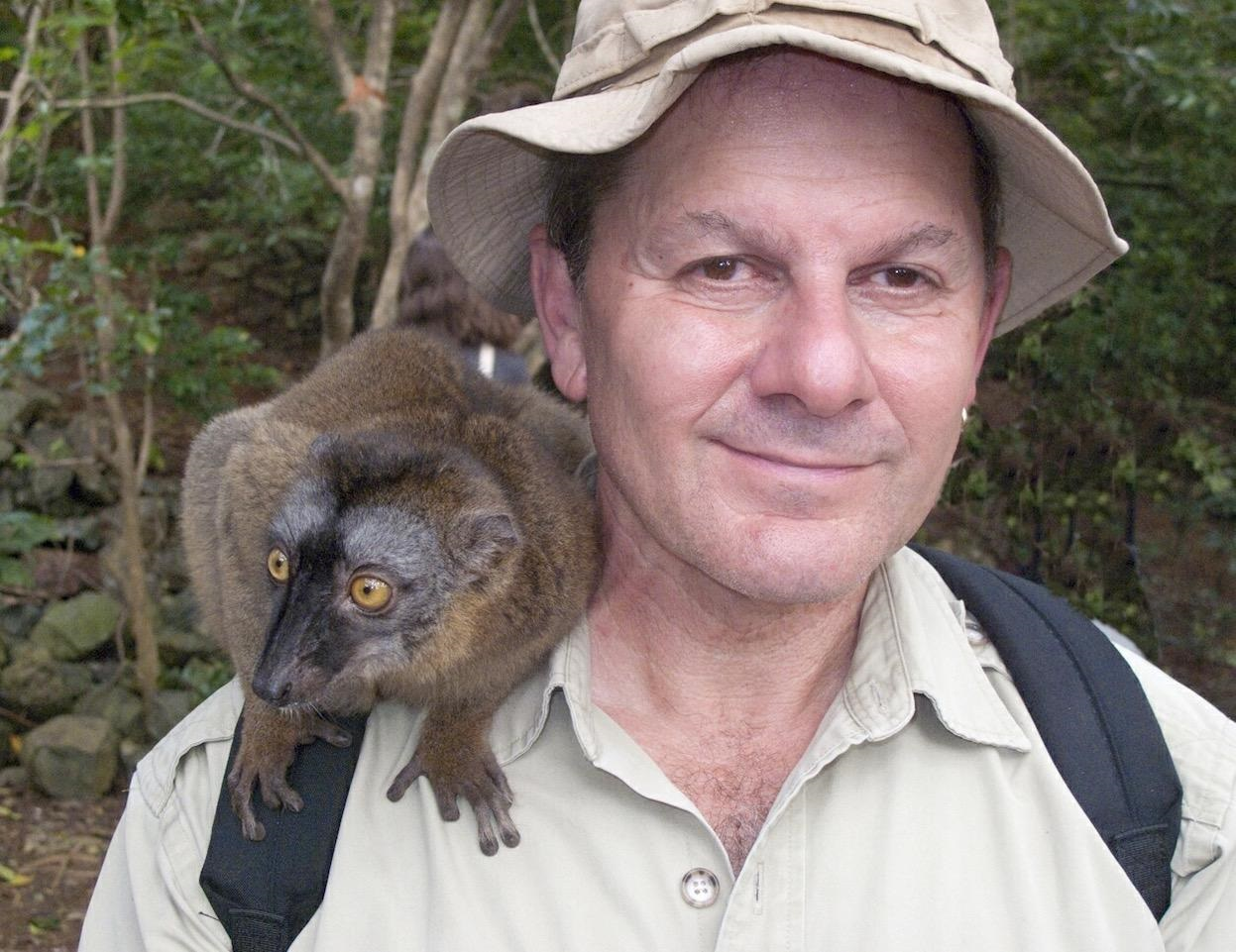 Alan Dean Foster with Mayotte brown lemur. M'bouzi island, French Comoros. Photo credit to Michael Medford.